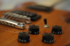 Knobs and buttons - Closeup shot of Washburn Idol WI-64 electric guitar with Tune-o-matic bridge stock images