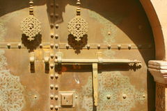Knobs and knockers on brass door. Detail seen on a door in Marrakech, Morocco Stock Photo
