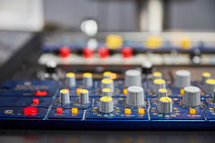 Knobs on mixing console Stock Photos