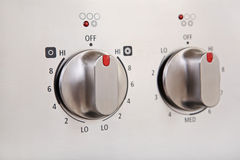 Knobs on a modern stainless steel stove Royalty Free Stock Images