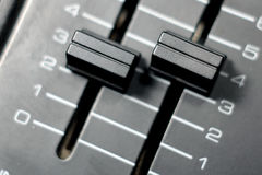 Knobs of the stereo audio console Royalty Free Stock Photo