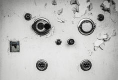 Knobs on a wall in an abandoned hospital. Random knobs on a wall in an abandoned hospital stock photo