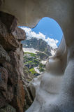 Knobtop mountain framed by snow crevasse Royalty Free Stock Photo