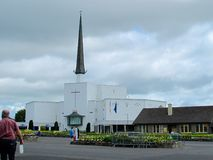 Knock Basilica. This photograph was taken at Knock Shrine in July 2018. nnThe basilica of Knock is a Roman Catholic Church of the Latin Rite located in the small royalty free stock image