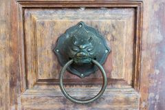 Knock the door. Made of antique brass stock image