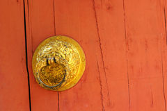 Knock door orange background Royalty Free Stock Photos
