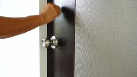 Knock the door. And rotate stock video
