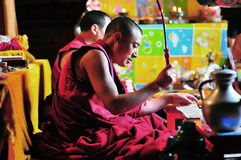 Knock a gong Monk. In Jokhang Temple,Tibet royalty free stock images