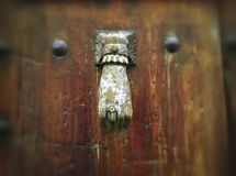 Knock, knock!. Old door with an iron hand Royalty Free Stock Images