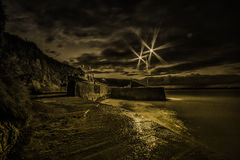 Knockadoon Watch TowerPier at night. The pier at Knoackadoon, Co. Cork, Ireland at night with an old style colouring to give it an atmospheric feel Royalty Free Stock Photos