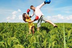 Knocked out by woman. Man knocked out by woman stock image