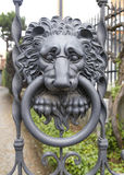 Knocker. Lionhead knocker on the gate stock photography