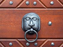 Knocker. A funny-looking door knocker with a ring royalty free stock photos