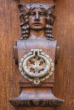 Knocker. Detail knockers historic carved wooden doors Stock Photos