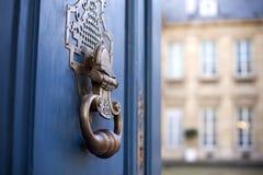 Knocker on a door Stock Images