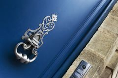 Knocker on a door royalty free stock image