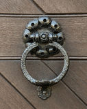 Knocker, hammered metal door knocker. The door to the vault in s. Andstone Royalty Free Stock Photos
