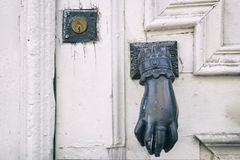 Knocker hand shaped and a lock Stock Photo