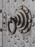 Knocker. On historic steel doors Royalty Free Stock Photography