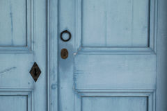 Knocker and lock on the blue wooden door Stock Photography