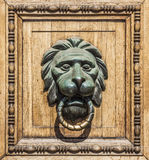Knocker. In the mouth of a lion Stock Photos