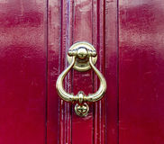 Knocker on red door Stock Image