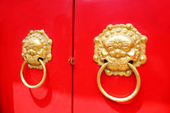 Knocker red door Stock Images