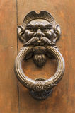 Knocker in the shape of head of a man with a mustache Stock Image