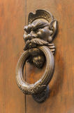 Knocker in the shape of head of a man with a mustache Royalty Free Stock Images