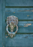Knocker. Thematic knocker on the old building Stock Images