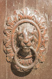 Knocker in wood and bronze Stock Photos