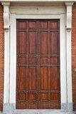 Knocker and wood  door in a church crenna gallarate varese Royalty Free Stock Photography