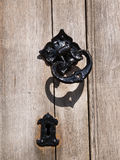Knocker on wooden door. Door knocker and keyhole on wooden door stock image