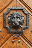 Knocker on wooden door Royalty Free Stock Images