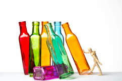 Knocking bottles down. A mannequin is pushing some bottles and can knock all of them down. On a white background. It can represent a stock market crash owing to royalty free illustration