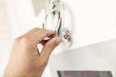Knocking with door knocker. Closeup of knocking on door with door knocker stock photography