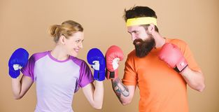 Knockout and energy. couple training in boxing gloves. train with coach. sportswear. punching, sport Success. Happy royalty free stock photography