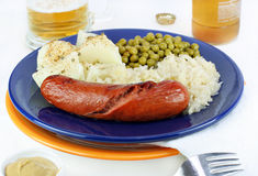 Knockwurst dinner with sauerkraut Stock Image