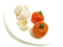 Knoflook en tomaat Stock Fotografie