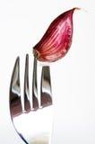 Knoflook en vork Stock Foto