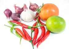 Knoflook, sjalot, citroen, tomaat en Spaanse peper royalty-vrije stock fotografie