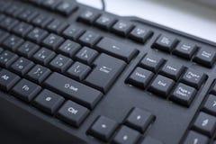 Knoop enterter close-up getelegrafeerd zwart toetsenbord royalty-vrije stock foto's