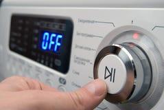 Knoop op een controle van wasmachinepaneel royalty-vrije stock afbeeldingen