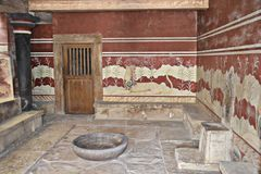 Knossos, Crete in Greece. The throne room was discovered in 1900 by archaeologist Arthur Evans in Knossos, Crete, in Greece. The Throne Room was built in the stock images
