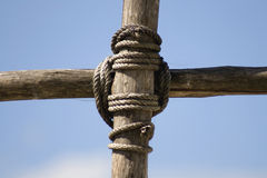 Knot. Rope knot on a wooden cross structure Royalty Free Stock Images