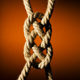 Knot. Close up shot of a rope with a knot Royalty Free Stock Photos