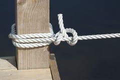 Knot. Tied round a pillar Stock Photos