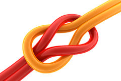 Knot. 3d image showing a knot made of orange and red ropes. Concept representing problem solving Stock Image