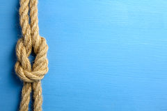 Knot. On blue wooden background Stock Images