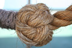 Knot on a boat. Roung knot made by seamen stock photos